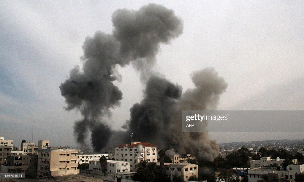 Smoke rises after an Israeli air strike on Gaza City, on November 21, 2012. A new wave of Israeli raids on Gaza killed 11 people, including a child who died when the tower housing AFP's office was struck for the second time in 24 hours. The Israeli military had no immediate comment on the second strike.