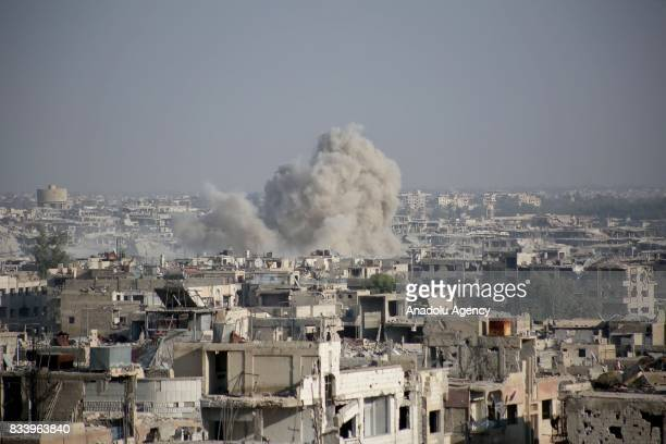 Smoke rises after Assad regime forces' carried out an air strike at the Ein Terma town of Eastern Ghouta which is a deconflict zone under control of...