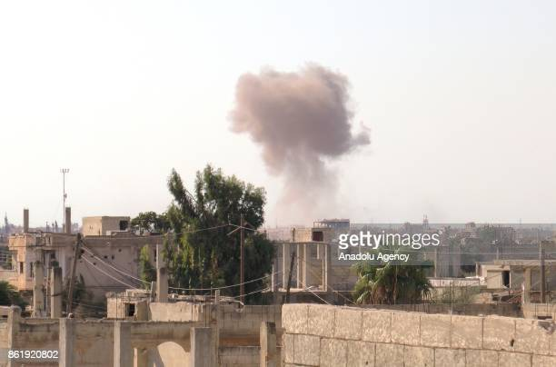 Smoke rises after Assad regime forces carried out an airstrike to deconflict zone Talbiseh town of Homs Syria on October 16 2017