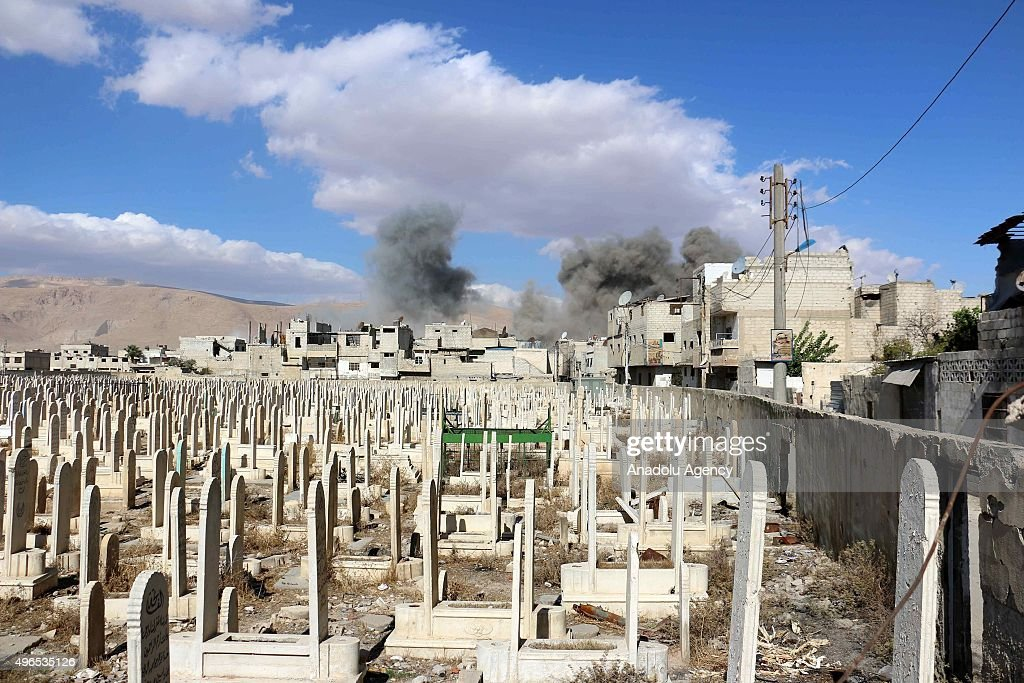 Smoke rises after Assad regime forces' strike, staged to residential areas, in Douma District of East Ghouta region of Damascus, Syria on November 10, 2015.