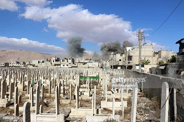 Smoke rises after Assad regime forces' strike staged to residential areas in Douma District of East Ghouta region of Damascus Syria on November 10...
