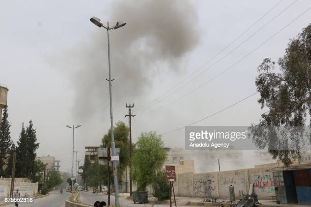Smoke rises after Assad Regime's airstrike hit residential areas at the Saqba town of Eastern Ghouta in Damascus Syria on May 1 2017