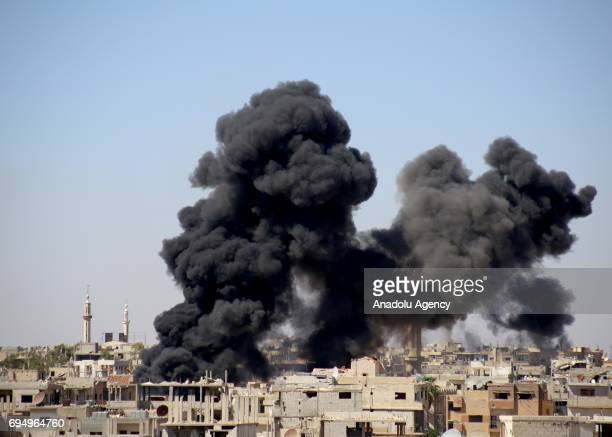 Smoke rises after Assad regime's airstrike over residential areas in Daraa Syria on June 11 2017