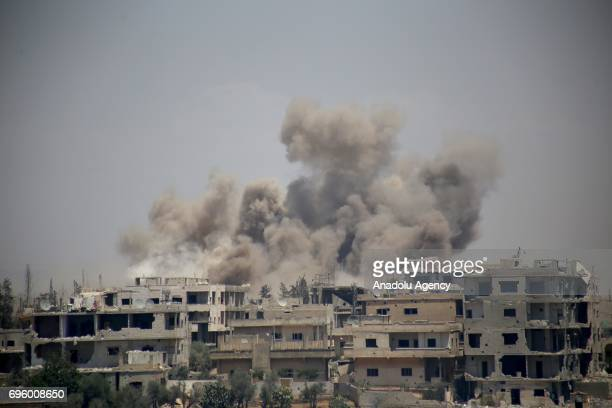 Smoke rises after Assad regime's airstrike over residential areas in Daraa Syria on June 14 2017