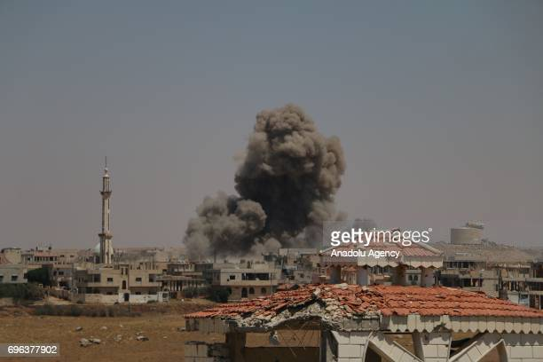 Smoke rises after Assad regime's barrel bomb airstrike over residential areas in Daraa Syria on June 15 2017 At least 1 civilian dead and 11 others...
