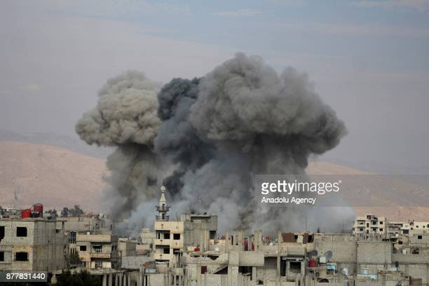 Smoke rises after Assad regime's warcrafts carried out airstrikes over Arbin of the Eastern Ghouta region of Damascus in Syria on November 23 2017