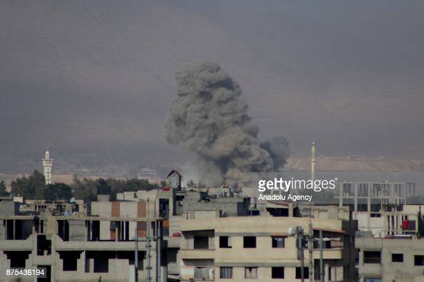Smoke rises after Assad regime's warcrafts carry out intensifying airstrikes over residential areas of Arbin town of the Eastern Ghouta region of...