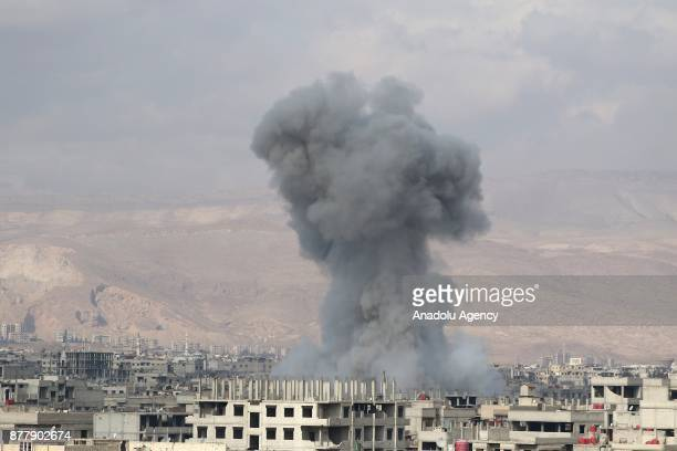 Smoke rises after Assad regime's warplane carried out airstrikes over Arbin town of the Eastern Ghouta region in Damascus Syria on November 23 2017