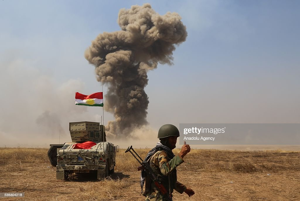 Smoke rises after coalition forces' aircrafts hit Daesh targets during an operation led by Peshmerga forces against Daesh during an operation in Hazer region Mosul, Iraq on May 29, 2016.