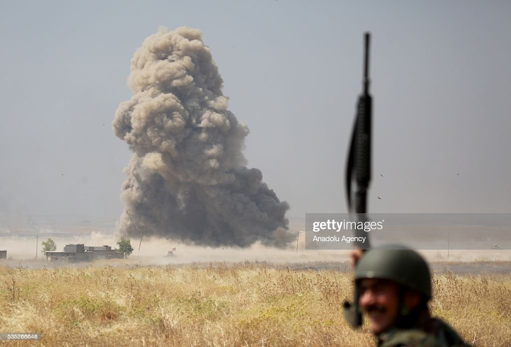 Smoke rises after coalition forces hit Daesh targets during an operation led by Peshmerga forces against Daesh terrorists in Hazer region Mosul, Iraq on May 29, 2016. Coalition forces support the operation with warcrafts.