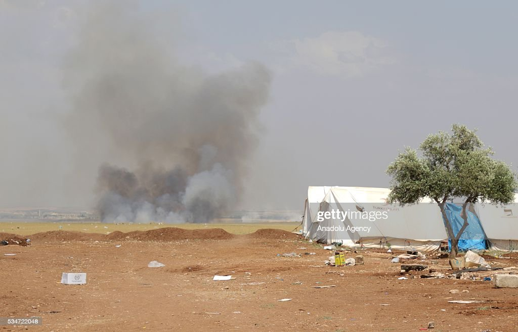 Smoke rises after Daesh's howitzer attack at al-Hilal Tent City in Azaz District of Aleppo, Syria on May 27, 2016.