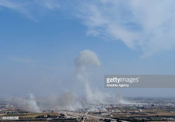 Smoke rises after Free Syrian Army fighters supported by the Turkish Armed Forces attack to the Daesh positions in AlBab town of Aleppo during the...