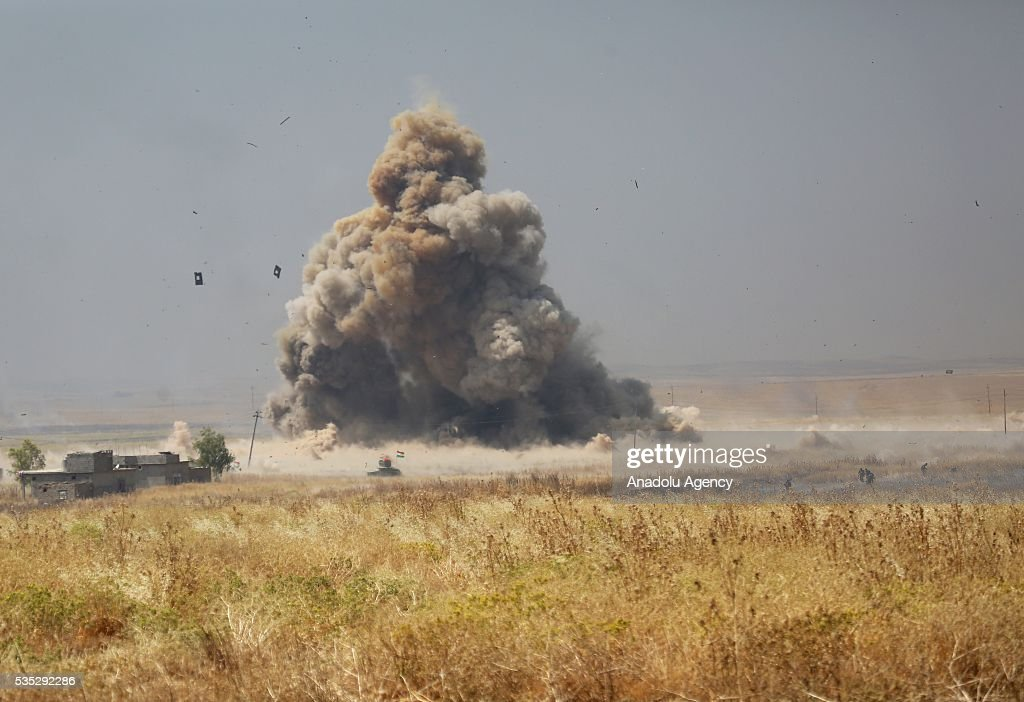 Smoke rises after Peshmerga forces destroy Daesh terrorist's vehicle trying to sneak into Peshmerga front during an operation in Hazer region Mosul, Iraq on May 29, 2016. Coalition forces support the operation with warcrafts.