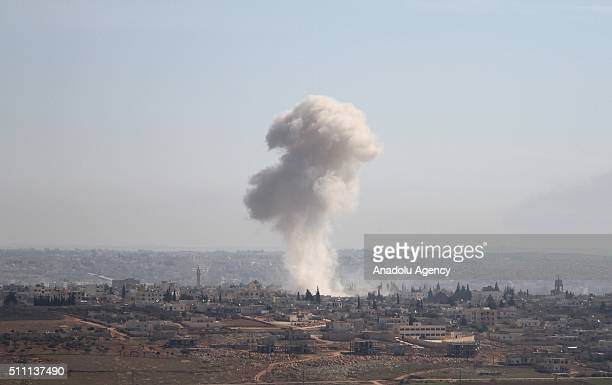 Smoke rises after Russian forces' airstrike over residential areas in Tamur village of Aleppo Syria on February 18 2016 Several casualties reported