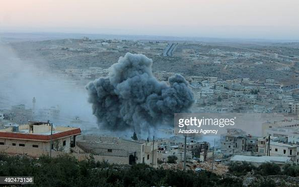 Smoke rises after Russian war crafts hit the Syrian opposition controlled town Daret Ezza in Aleppo Syria on October 13 2015