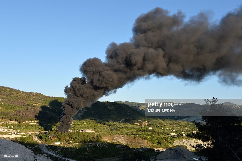 Smoke rises after shelling on al-Turkman mountains in the Latakia province, western Syria on April 25, 2013. The White House said that Syria had likely used chemical weapons against rebel forces on a 'small scale,' but emphasized US spy agencies were still not 100 percent sure of the assessment.