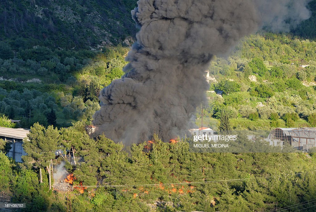 Smoke rises after shelling on al-Turkman mountains in the Latakia province, western Syria on April 25, 2013. The White House said that Syria had likely used chemical weapons against rebel forces on a 'small scale,' but emphasized US spy agencies were still not 100 percent sure of the assessment. AFP PHOTO / MIGUEL MEDINA