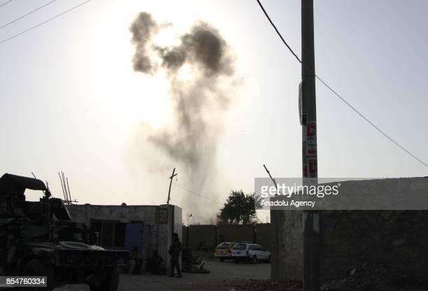 Smoke rises after suicide bomber attacked on Kabul International Airport in Kabul Afghanistan on September 27 2017 An Afghan woman was killed and 11...