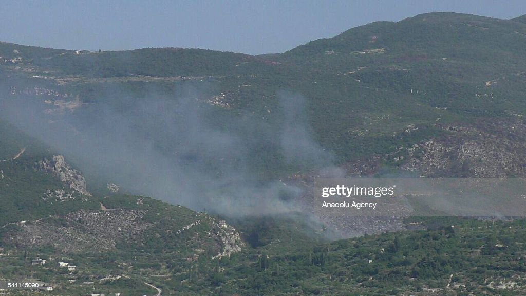 Smoke rises after Syrian oppositions attack to Jabal al-Akrad district as they took control of some villages and hills in Lattakia, Syria on July 1, 2016.