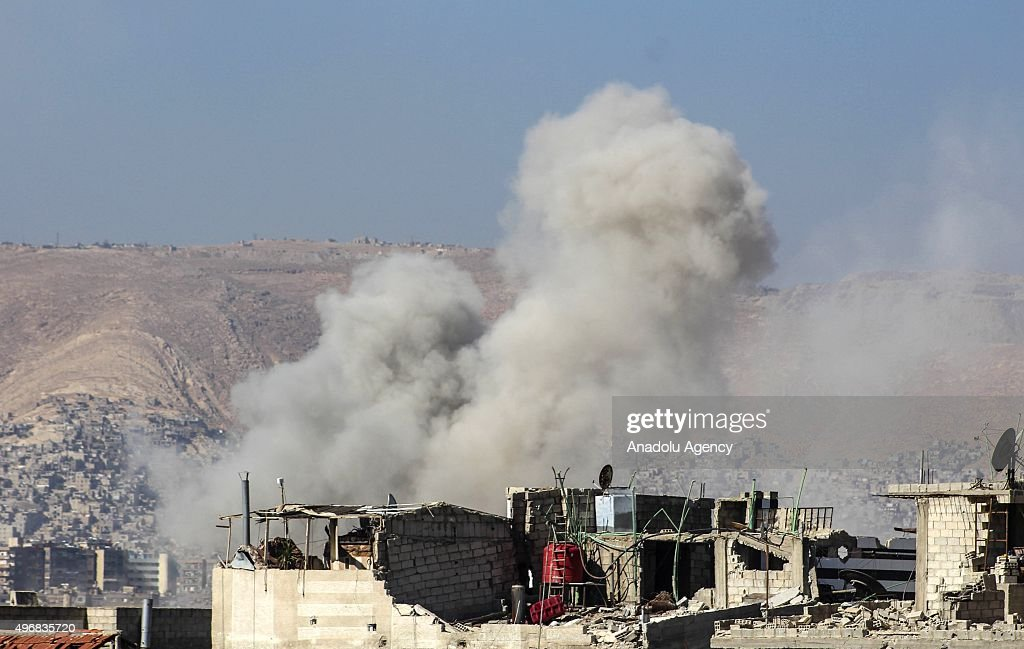 Smoke rises after the Assad regime forces conducted air strikes to oppositioncontrolled Cobar region of Damascus Syria on November 12 2015