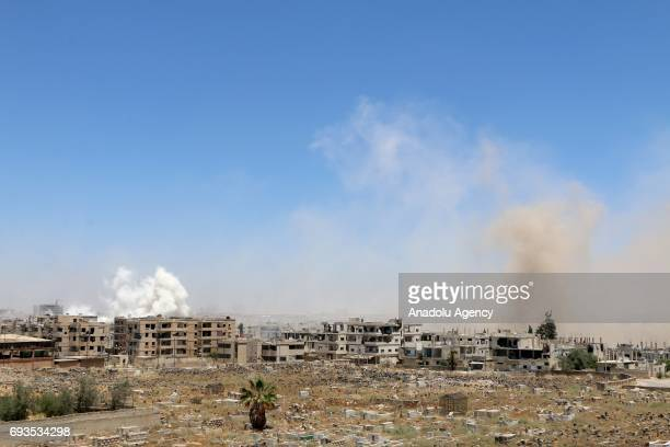 Smoke rises after the attacks by the Assad regime and its supporter foreign terrorist groups in Daraa Syria on June 7 2017 According to civil defense...
