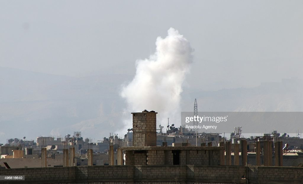 Smoke rises after the Russian forces conducting air strikes to Cobar region of Damascus Syria on November 12 2015