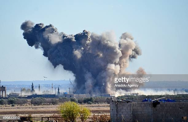 Smoke rises after the USled coalition airstrikes' hits DAESH positions at Brekida village in Aleppo Syria on December 03 2015