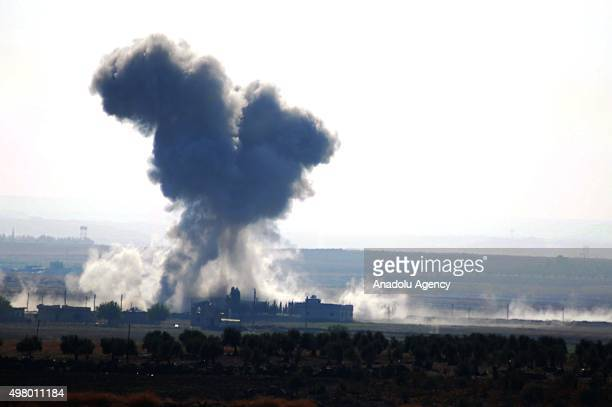 Smoke rises after the USled coalition airstrikes pound DAESH positions at Harceli and Delhi villages in Aleppo Syria on November 20 2015