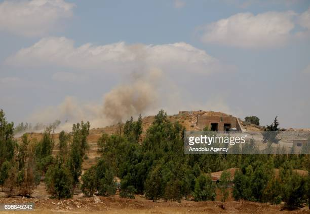 Smoke rises after war crafts belonging to Assad regime's hit opposition controlled areas in Daraa Syria on June 20 2017