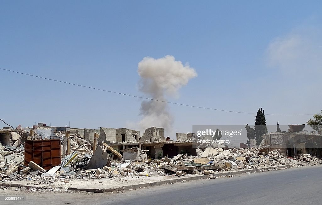 Smoke rises after war crafts belonging to Russian Army carried out airstrikes over opposition controlled Kafr Hamrah village of Aleppo, Syria on May 31, 2016.