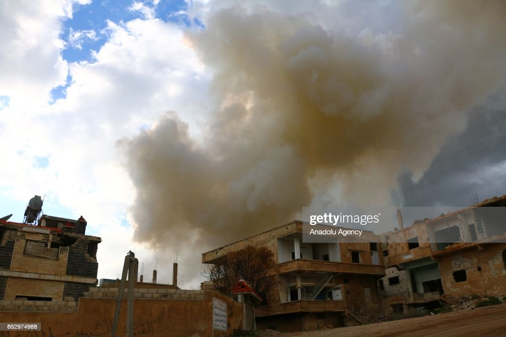 Smoke rises after warcrafts belonging to Assad Regime forces carried out airstrike in Daraa, Syria on March 13, 2017.