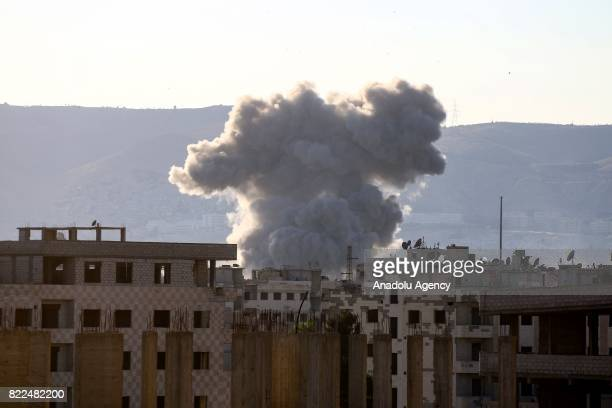 Smoke rises after warcrafts belonging to Assad regime forces carried out airstrikes over the deconflict zone Arbin town of Eastern Ghouta region in...