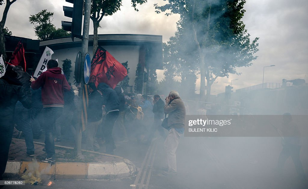 Smoke rises as anti-riot police attempt to disperse protesters at a May Day rally in Bakirkoy, a district of Istanbul, on May 1, 2016. Turkish labour activists and leftists marked the annual May Day holiday, with thousands of security deployed and bracing for trouble after the authorities refused to allow protests in central Taksim Square. / AFP / BULENT