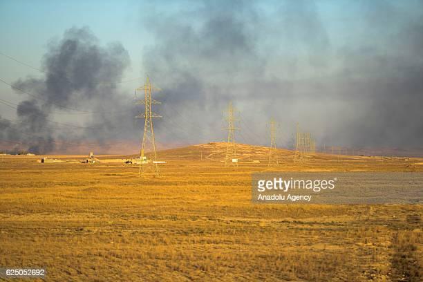 Smoke rises as Daesh terrorists run away from the Beac district of Mosul towards Raqqa in Mosul Iraq on November 22 2016 Daesh terrorists escaped...