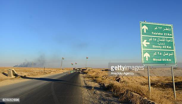 Smoke rises as Daesh terrorists run away from the Beac district of Mosul towards Raqqa in Mosul Iraq on November 22 2016 Daesh terrorists escaped...