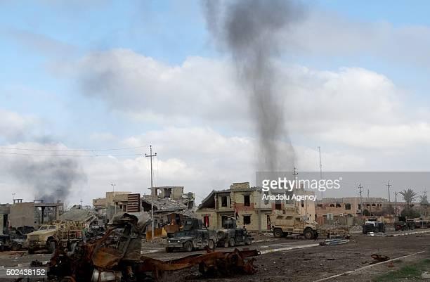 Smoke rises as Iraqi forces conduct an operation aiming to reseize the Ramadi from Daesh terrorist in alDubat neighborhood of Ramadi Iraq on December...