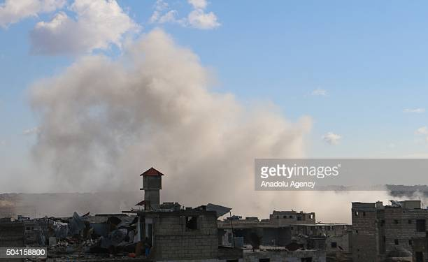 Smoke rises as Russian warplanes conduct air strikes targeting opposition controlled prison at opposition controlled Maret el Numan district of Idlib...