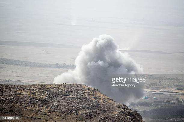 Smoke rises as US artillery units bomb the Deash positions with howitzer in the east of Mosul during an Operation to retake Iraq's Mosul from Deash...