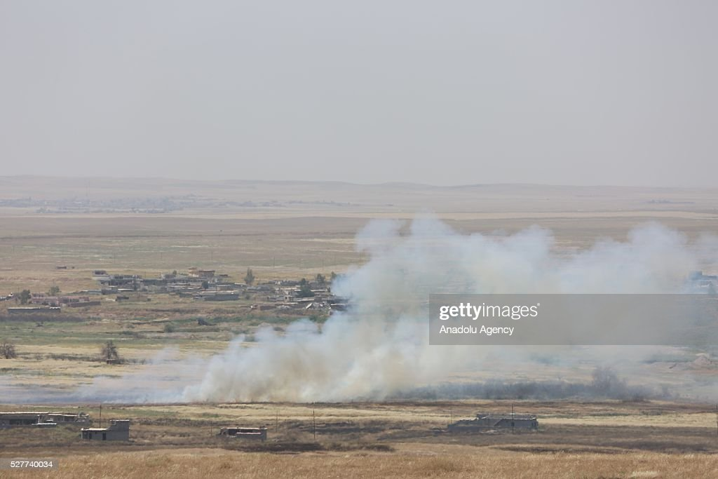 A smoke rises during clashes between Daesh and Peshmerga forces on Guve side of Peshmerga in Mosul's Mahmur district, Iraq on May 3, 2016.