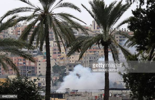 Smoke rises during clashes in Ain alHilweh camp Lebanon's largest Palestinian refugee camp near the southern coastal city of Sidon on February 28...