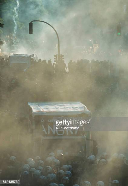Smoke rises during the 'Welcome to Hell' rally against the G20 summit in Hamburg northern Germany on July 6 that was broken up by police Leaders of...