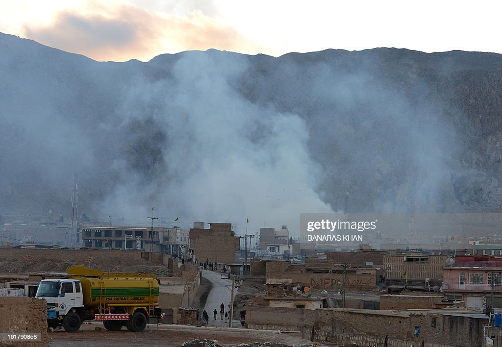 Smoke rises following a bomb explosion in Quetta on February 16, 2013. A remote-controlled bomb targeting Shiite Muslims killed 47 people including women and children and wounded more than 200 in Pakistan's insurgency-hit southwest on Saturday, police and officials said. AFP PHOTO/Banaras KHAN