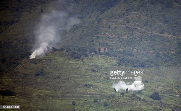 Smoke rises following alleged shelling by Indian troops in the Nakial Sector of Pakistanadministered Kashmir on August 18 2015 Kashmir has been...