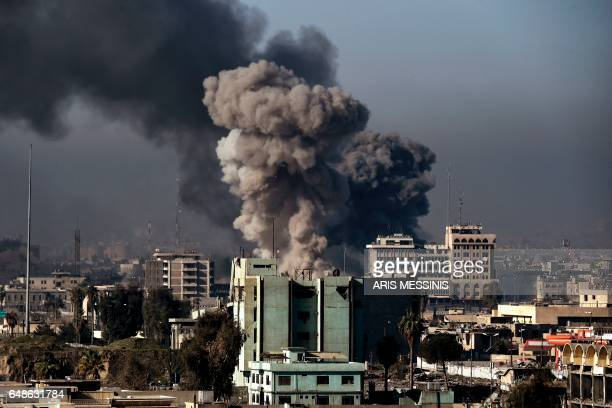 Smoke rises following an airstrike in western Mosul on March 6 during an offensive by Iraqi forces to retake the western parts of the city from...