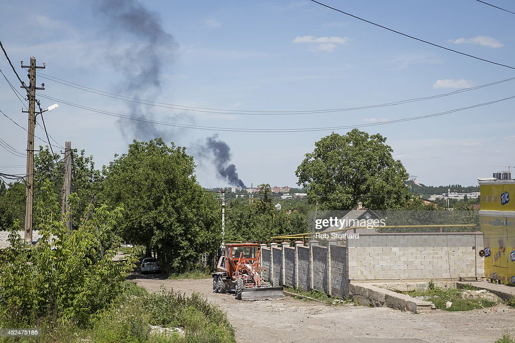 Smoke rises for a building close to the central railway station on July 21, 2014 in Donetsk, Ukraine. Local authorities warned residents in the area not to go outside or leave their homes whilst intense shelling set a market ablaze close to the station. The security situation is continuing to affect the investigation into the Malaysian Airlines flight MH17 crash and it is still unclear where or when the train containing the bodies of victims will be moved. Malaysian Airlines flight MH17 was travelling from Amsterdam to Kuala Lumpur when it crashed killing all 298 on board including 80 children. The aircraft was allegedly shot down by a missile and investigations continue over the perpetrators of the attack.