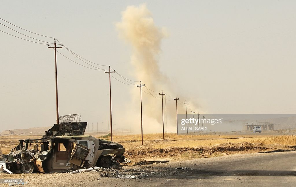 Smoke rises from a bomb planted by Islamic State militants after it was detonated near the Iraqi village of Tuz Khurmatu in Salaheddin province about...