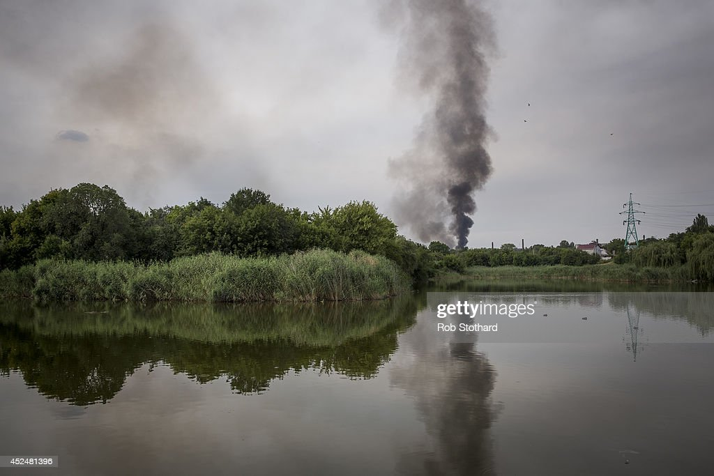 Smoke rises from a buliding damaged during fighting between pro-Russia rebels and Ukrainian government troops on July 21, 2014 in Donetsk, Ukraine. Local authorities warned residents in the area not to go outside or leave their homes whilst intense shelling set a market ablaze close to the station. The security situation is continuing to affect the investigation into the Malaysian Airlines flight MH17 crash and it is still unclear where or when the train containing the bodies of victims will be moved. Malaysian Airlines flight MH17 was travelling from Amsterdam to Kuala Lumpur when it crashed killing all 298 on board including 80 children. The aircraft was allegedly shot down by a missile and investigations continue over the perpetrators of the attack.