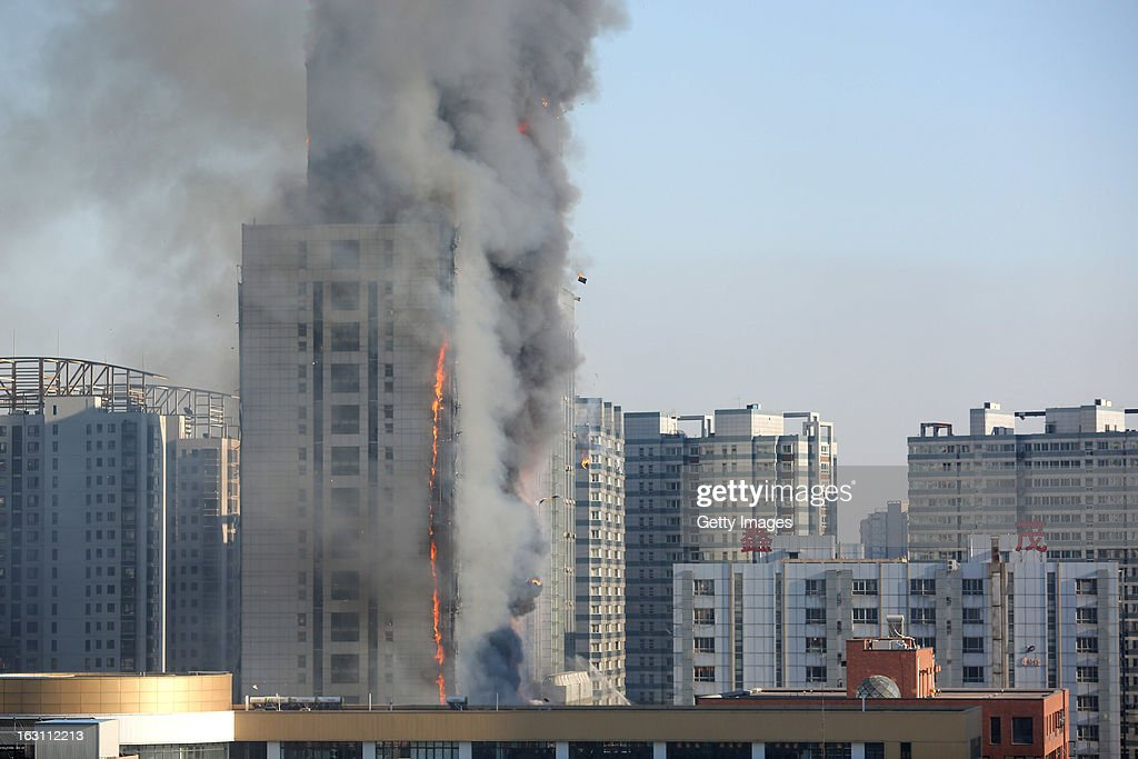 Smoke rises from a burning building at Xinmao Science Skill Park on March 4, 2013 in Tianjin, China. Fire broke out at about 4 p.m. Monday afternoon without any reports of casualties.