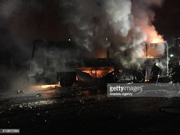 Smoke rises from a burning bus after military vehicles hit by Ankara blast close to government at Merasim street on the intersection of Inonu...