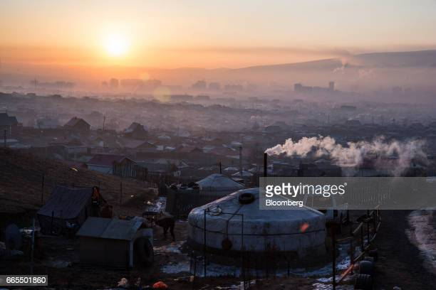 Smoke rises from a chimney in a ger district at sunrise in Ulaanbaatar Mongolia on Tuesday March 14 2017 The subzero winters in Ulaanbaatar force...